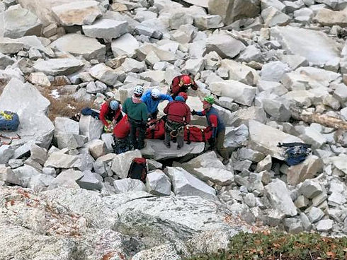 Ice climber placed in Bauman Bag brought by Mono County SAR team members that were inserted by H-40 preparing the victim for a hoist in challenging terrain. – (1/1/2018 Tanya Godinez)